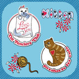 Klistermärkeetikett med bilden av katter Arkivbilder