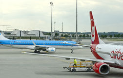 KLM & Air Berlin airplanes. Busy European Airport - KLM & Air Berlin airplanes Stock Images