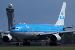 KLM plane taxiing on Amsterdam Airport Schiphol AMS, cloudy. KLM airplane landing in AMS airport, Netherlands royalty free stock images