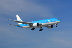 KLM Asia Boeing 777. A KLM 777-300 on final approach to land. This 777 has the Asia livery. This is used to circumvent Chinese law when flying into Taiwan Royalty Free Stock Photo