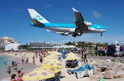 A KLM Boeing 747 lands over Maho Beach in St Martin. SAINT MARTIN, DUTCH ANTILLES --30 NOVEMBER 2014-- The beach at Maho Bay is one of the world's premier Royalty Free Stock Photo