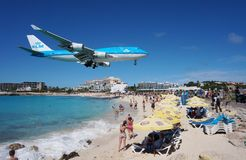 A KLM Boeing 747 lands over Maho Beach in St Martin. SAINT MARTIN, DUTCH ANTILLES --30 NOVEMBER 2014-- The beach at Maho Bay is one of the world's premier Stock Photography