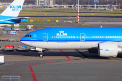 KLM Boeing 777. Pulling into the gate at Schiphol Amsterdam Airport stock images