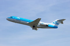 KLM Cityhopper Fokker F70 airplane. AMSTERDAM - APRIL 21, 2015: KLM Cityhopper Fokker F70 aircraft taking off from Schiphol airport Royalty Free Stock Images