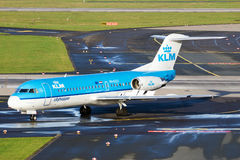 KLM Cityhopper Fokker F70 airplane. DUSSELDORF, GERMANY - DEC 21, 2015: KLM Cityhopper Fokker F70 taxiing after landing at Dusseldorf Airport Stock Photography