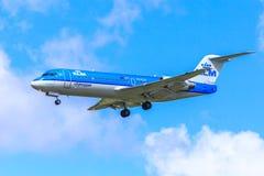 KLM Fokker 70 landing. A KLM Fokker 70 approaching to land Stock Photography