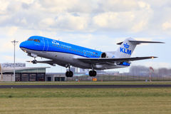 KLM Fokker 70 new livery. A KLM Fokker 70 in new livery is taking off Royalty Free Stock Photos