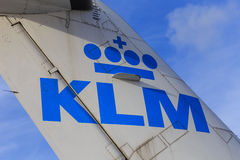KLM logo on tail. Detail of the KLM logo on the tail of a jet, blue sky background Stock Images