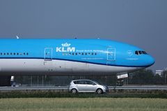 KLM plane doing taxi on runway, AMS Airport. KLM airplane taxiing in airport, Amsterdam Airport, Schiphol, AMS royalty free stock photos