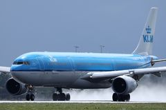 KLM plane landing on airport stock photography