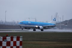 KLM plane taxiing on Amsterdam Airport Schiphol AMS, cloudy. KLM airplane landing in AMS airport, Netherlands stock photos
