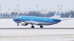 KLM Royal Dutch Airlines Boeing 737-800 PH-BXZ. KLM Airlines Boeing 737-800 landing in Munich Airport MUC, Germany. Winter with snow on runway stock video footage