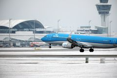 KLM Royal Dutch Airlines Boeing 737-800 PH-BXZ landing on snowy runway Royalty Free Stock Photography