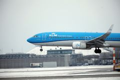 KLM Royal Dutch Airlines Boeing 737-800 PH-BXZ landing on snowy runway Royalty Free Stock Images