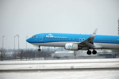 KLM Royal Dutch Airlines Boeing 737-800 PH-BXZ landing on snowy runway Royalty Free Stock Photo