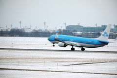 KLM Royal Dutch Airlines Boeing 737-800 PH-BXZ landing on snowy runway Stock Photo
