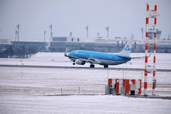 KLM Royal Dutch Airlines Boeing 737-800 PH-BXZ landing on snowy runway Stock Image