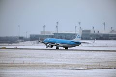 KLM Royal Dutch Airlines Boeing 737-800 PH-BXZ landing on snowy runway Royalty Free Stock Image