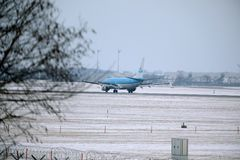 KLM Royal Dutch Airlines Boeing 737-800 PH-BXZ lands on snowy runway Royalty Free Stock Photography