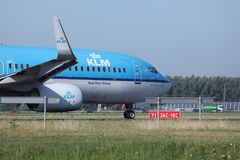 KLM Royal Dutch Airlines jet doing taxi in Schiphol Airport, Amsterdam. Closeup view of cabin crew Stock Photography