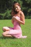 klänningflickapink Arkivfoto