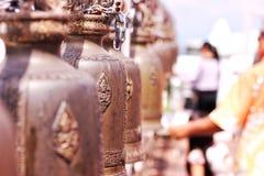 Klocka är en tro i buddhism Arkivbilder