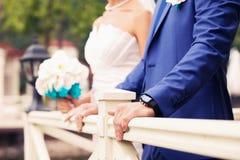 Klocka av brudgummen Royaltyfria Bilder