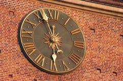 klocka guld- krakow Arkivfoton