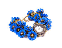 Klocka med blåa blommor Arkivbild