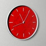 Klocka med den röda klockaframsidan Royaltyfria Bilder
