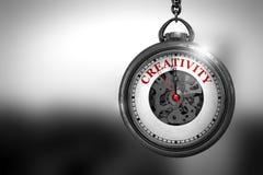 Klocka med röd text för kreativitet på den framsida illustration 3d Royaltyfria Foton