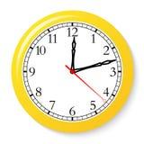 Klocka på en vit bakgrund Fotografering för Bildbyråer