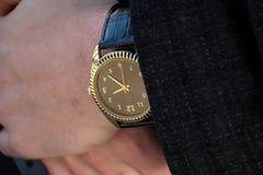 Klocka på handen Fotografering för Bildbyråer