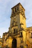 Klocka torn av BasÃlica Arcos de la Frontera Spanien Arkivfoton