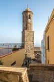 Klocka torn av domkyrkan Sant Antonio Abate i Castelsardo Royaltyfri Bild
