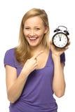 klockaholdingkvinna Royaltyfri Bild