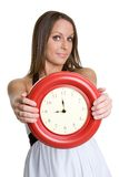 klockaholdingkvinna arkivbild