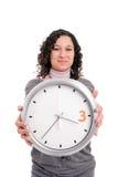 klockaholdingkvinna royaltyfri foto