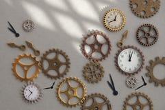 Klockakugghjul och kuggar arkivbild