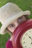 klockakvinna arkivfoto