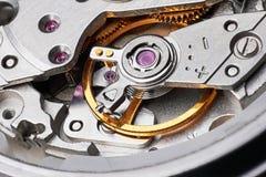 Klockamekanism med kugghjul Arkivfoto