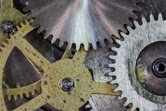 Klockan utrustar och förser med kuggar makrobakgrund Arkivfoto