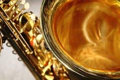 klockasaxofon royaltyfria bilder