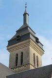 Klockatornet av den St Martin kyrkan i Luché, Frankrike Royaltyfria Foton