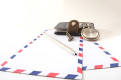 Klockor för anteckningsbokkuvertblyertspenna Arkivfoto
