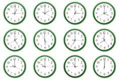Klockor - 12 olika timmar Royaltyfri Fotografi
