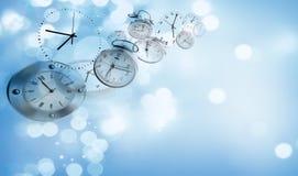 Klockor på blått Arkivbild