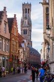 Klockstapel av det Bruges tornet i afton royaltyfria bilder