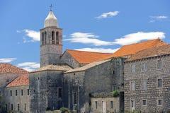 Klockstapel och kloster Royaltyfri Foto