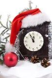 Klok in christmasshoed met bont-boom Stock Afbeeldingen